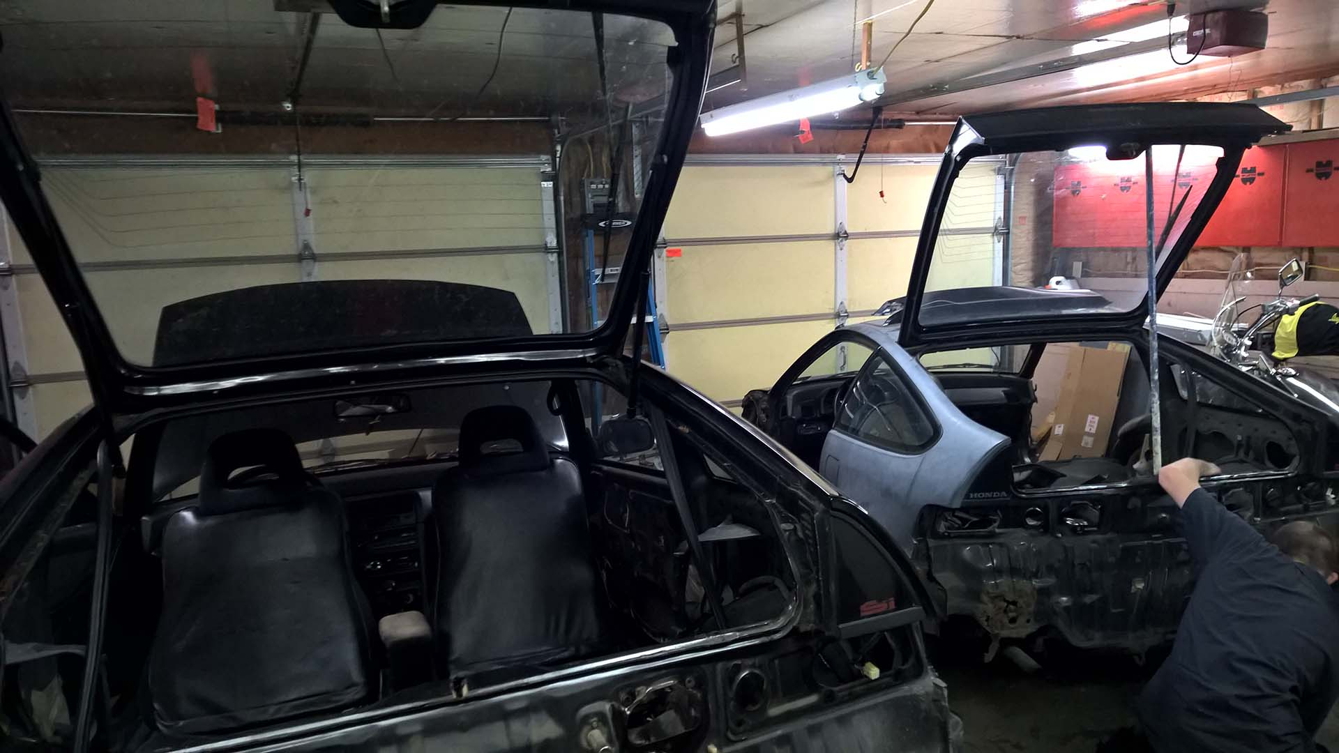 Working on Removing a Piece of the Rear Panel from the First CRX