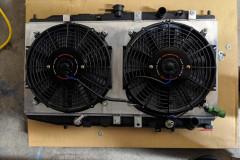Mishimoto fan shroud mounted on the OEM radiator